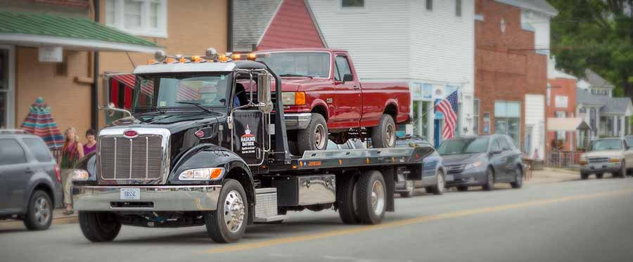 tow truck with pick-up truck